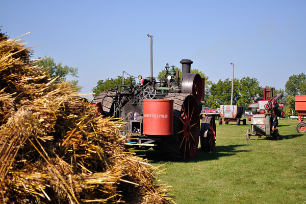 Tractor used for threshing and a straw stack
