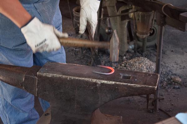 Blacksmith making a horseshoe