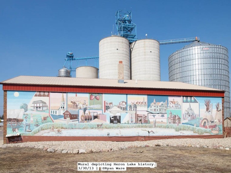 A mural depicting community foundations with it's current foundation of an agricultural economy in the background